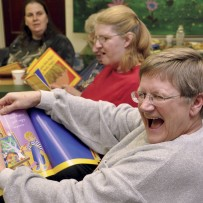 Woman laughing with book