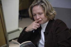 Woman reading and thinking