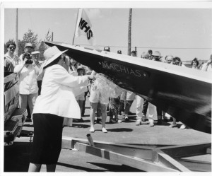 Deedee Schwartz, longtime Executive Director of the MHC, christens the bateau Machias in 1990.