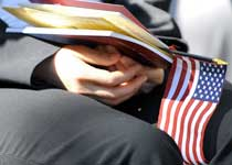 Book, hand, and flag
